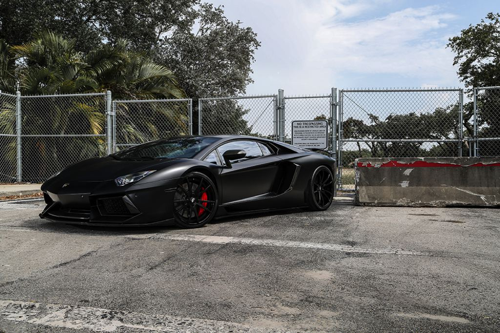 Matte Black Lamborghini Aventador Sitting on Forgiato Wheels, Installation by Mansory
